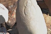 Будда на камне